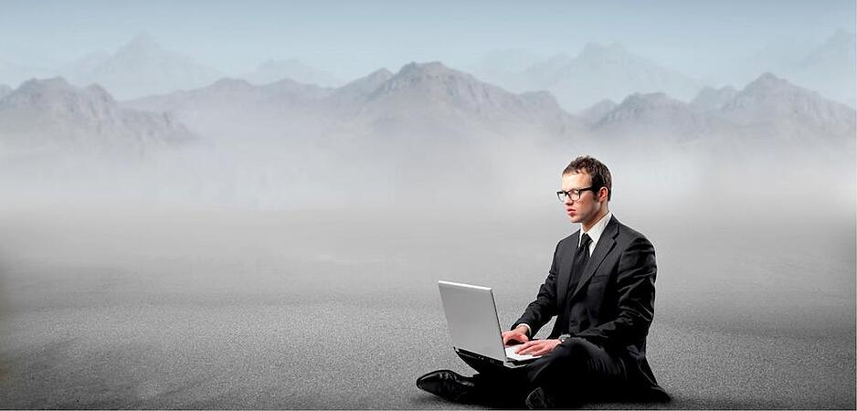 Fog Computing_ man on computer in flog